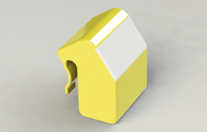 This is a rendering of the first concept.  A motion sensor dispenser that would clip onto a dog toy bin.  We eventually determined that a motion sensor was not accurate enough for the application and that dog toy bins vary too much in shape and size.