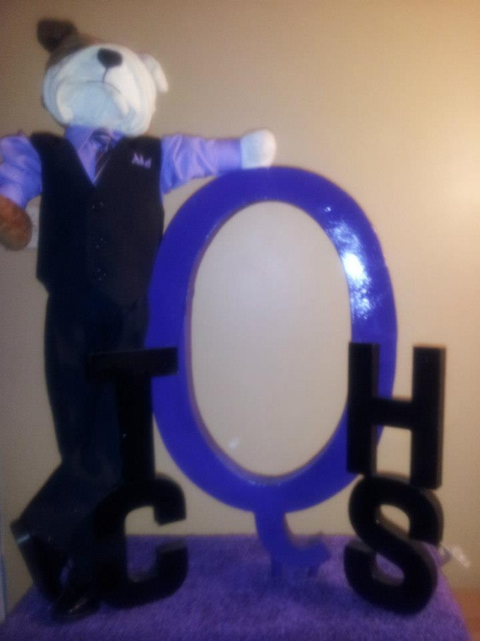 Q Dog statue commissioned by the TCHS mentoring program in honor of the Atlanta PKK Chapter of Omega Psi Phi.. - May 2013