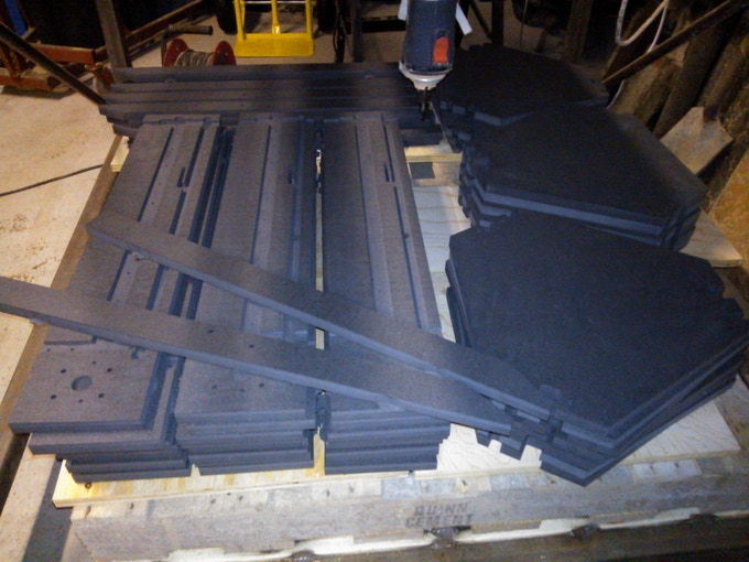 First batch of black valchromat panel sets, as supplied by our CNC partners. Per default, we will treat the panels with hard wax oil or a 2 pack varnish, depending on production volumes. The resulting finish resembles slate.