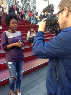 Correspondent Georgette Pierre filming in Times Square