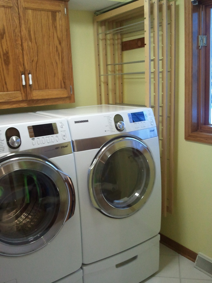 """Maximize your laundry room - 4 frames can dry two loads of wash in a 14"""" wide space."""
