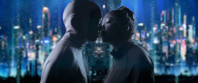Occupant kissing Loved One as she is about to depart on the space elevator. (The elevator tower base structure behind splits them in frame. Symbolic of their separation).