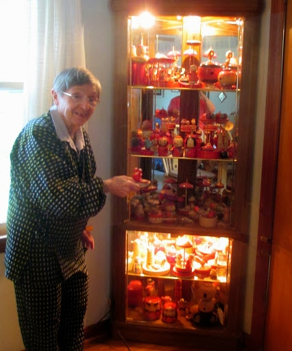 Janell showing off one cabinet of her top collection (October 2013)