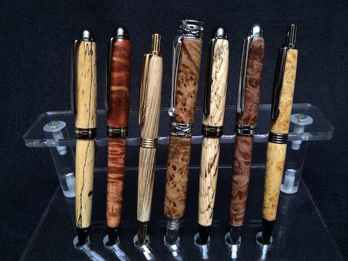 Left to right: Spalted Tamarind, Curly Koa, Spalted Hackberry, Black Ash Burl, Spalted Tiger Oak, Maple Burl, Box Elder Burl (Matte)