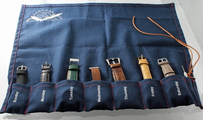 Blue watch roll containing seven watches and a pin pusher for your reference.