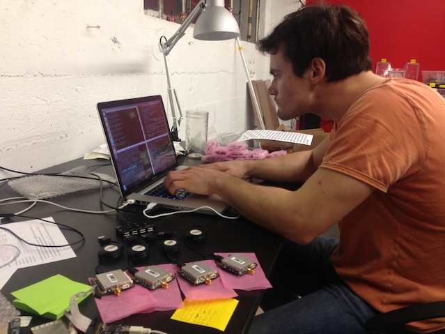 Colin hacking away testing the units before shipment