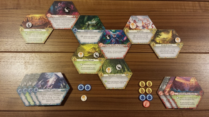 Midpoint of 2 player game. Each player has a stack of unraveled sites and acquired seed tokens at bottom left and right.