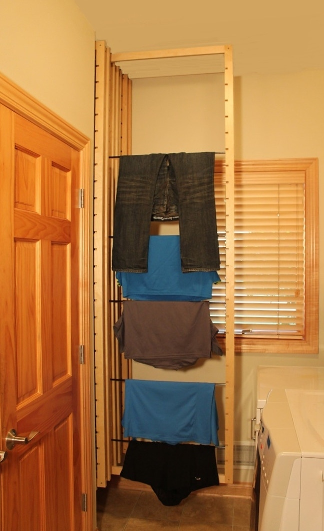 Poles are easily adjusted to work with different size clothes.