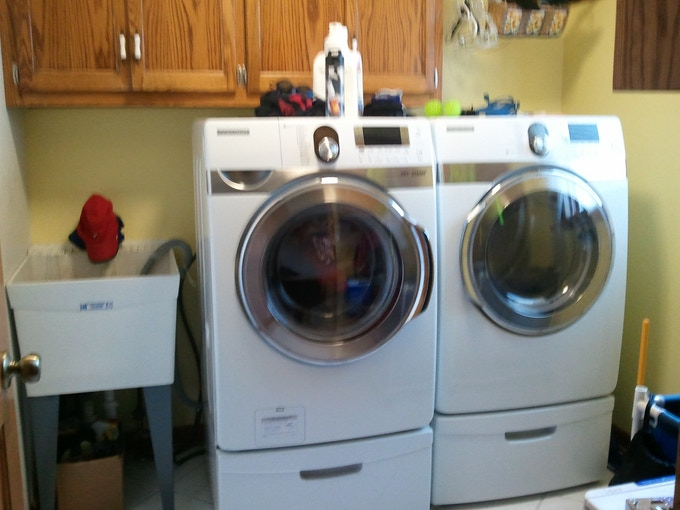 """Before - Moving the washer and dryer over to gain a 14"""" space on the right."""