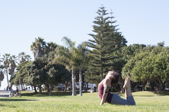 Practice yoga in the park with your favorite teacher's guidance.