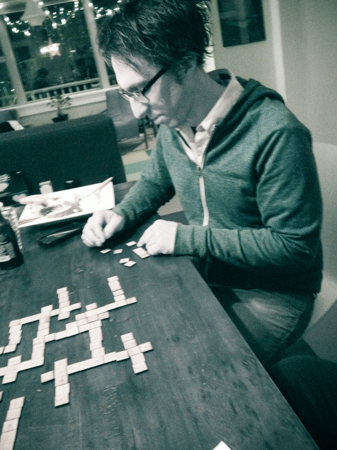 Andy racking up some points and strategically choosing replacement tiles from the Pijin Pool.