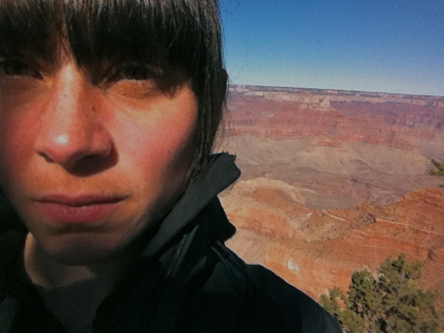 Beth at the edge of the Grand Canyon