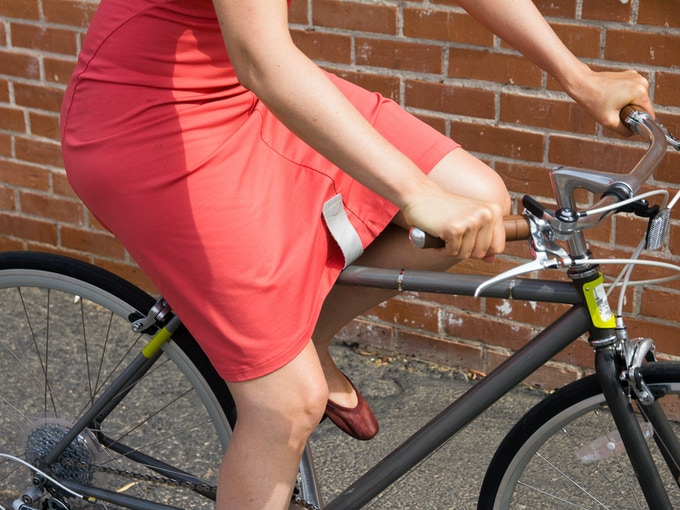 For shorter skirts, put the KATCH on the front, it's weight will hold the fabric down.