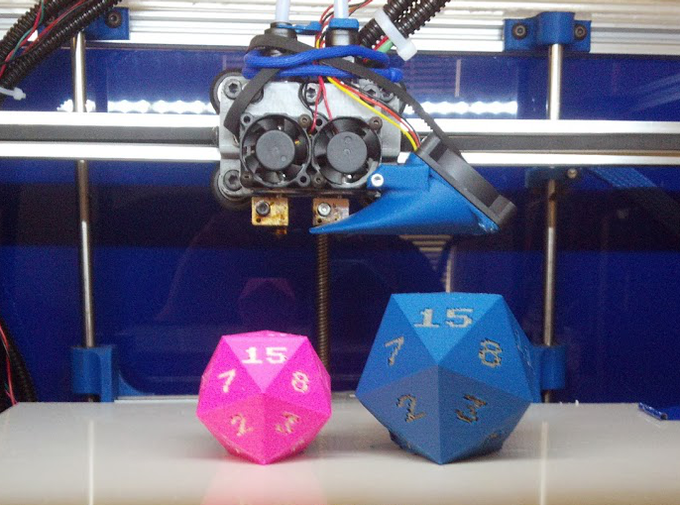 Left: pink PLA with white PLA numbers; Right: blue ABS with grey ABS numbers (d20 by PuppyKhan, thing:28681)