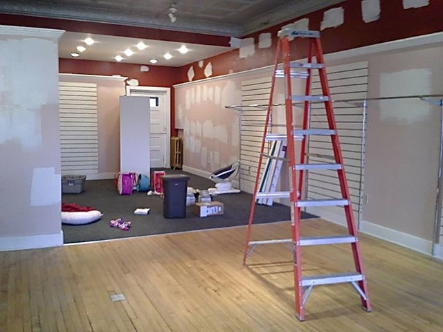 Our existing play area (and back third of the store) before we moved in and renovated.
