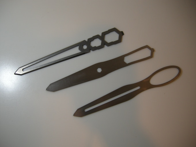 """A couple of the prototypes (bottom two) made during the intensive design process, showing the evolution of the """"wasp waist"""" and """"needle hole"""" thematic design elements into the current stylized version embodied by your Tiletto."""