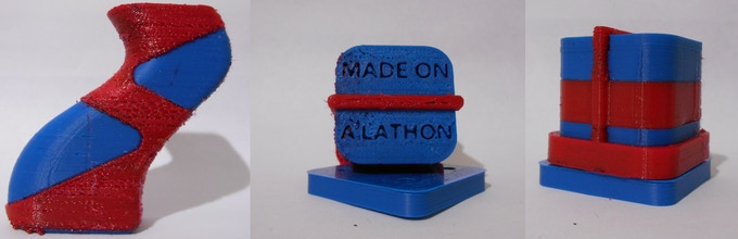 Overmolded Handle and example cube. Blue is ABS and red is rubber-like TPE