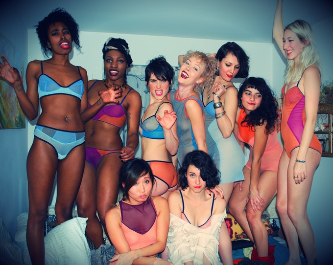 Rachel with her models at a basement fashion show