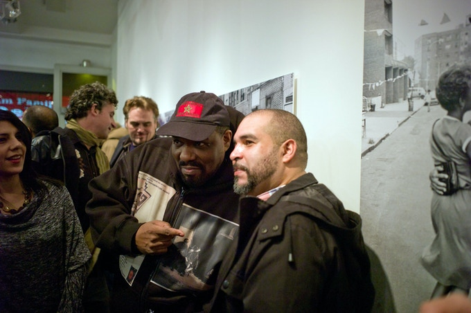 "Hip hop pioneer Afrika Bambaataa and BDC volunteer Ed Garcia Conde at the opening reception of ""Seis del Sur: Dispatches from Home by Six Nuyorican Photographers"""