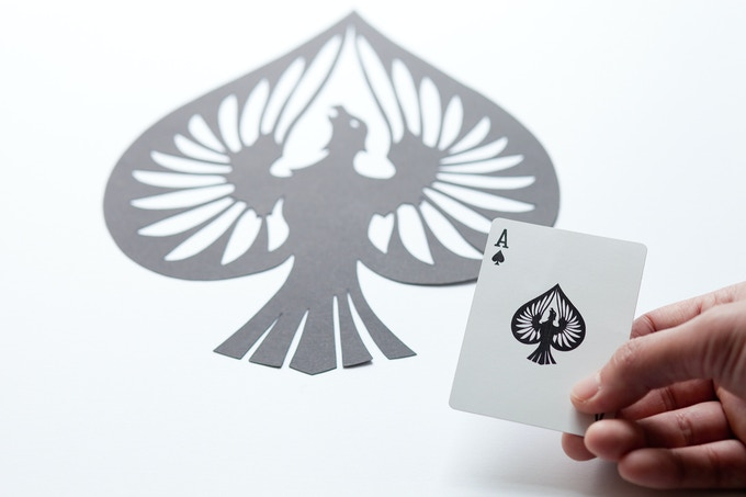 The Ace of Spades from the Curator deck pictured with the original artwork. The Clipped Wings deck will have the same stock and finish as the Curator deck.