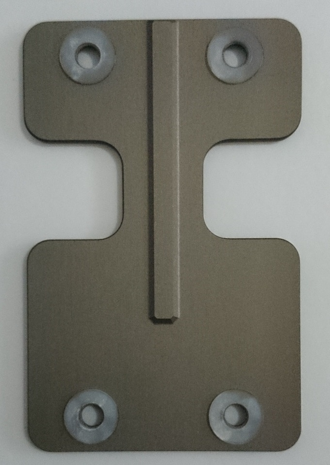 """Underneath the top plate is a """"stopper"""" in the middle which prevents keys from moving to the other side and clashing"""