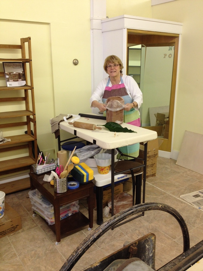 We give member Debbie Angell the award for most creative use of space!  She's figured out how to have a hand building station on top of her wheel thats easily moved and put away for when she wants to throw.