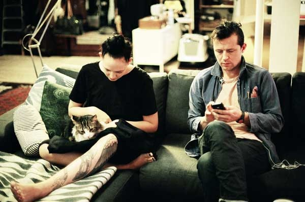 Artist Robert Montgomery with his girlfriend Lucy Newman and their cat