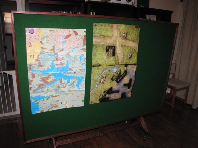 Upright with a few maps attached with magnets.