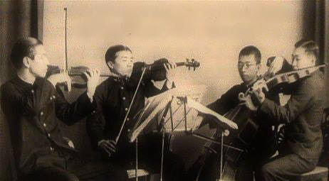Ifukube is seen on the far left playing violin with the Sapporo Philharmonic String Quartet in 1933. Photo Courtesy of www.akiraifukube.org