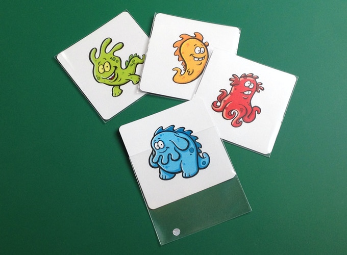 Square 70mm x 70mm cards fit into standard card sleeves.