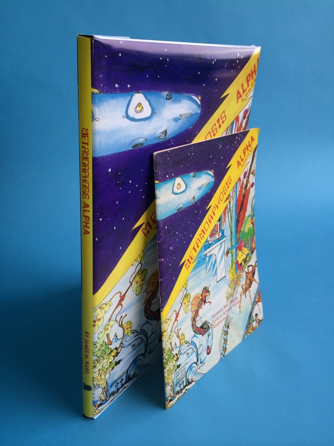 """What do you mean, """"oversized hardcover""""? THIS is what we mean! Here is the mockup that was shown off at Gary Con 2014, with a copy of MA 1st printing in front of it. Yes, """"oversized"""" is big! Note: This is only a mockup; final cover design may vary."""