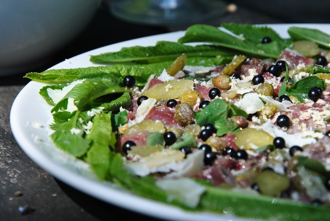 HGC Starter: Pigeon Carpaccio with Elderberries & Wild Horseradish.