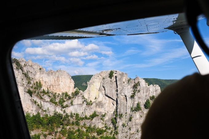 We rented a plane to get aerial footage. Flying by Seneca Rocks here.