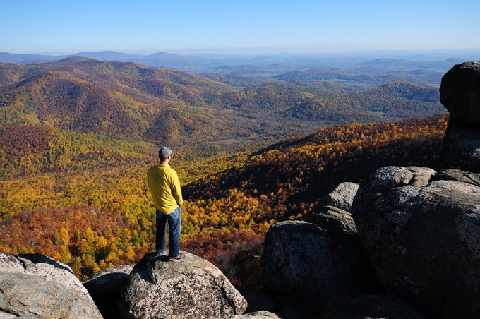 Alpine Jesse contemplates thinking about thoughts on top of Old Rag Mtn.