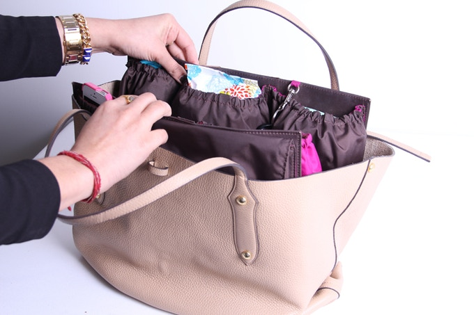 All Of Your Essential Baby Items In Handbag