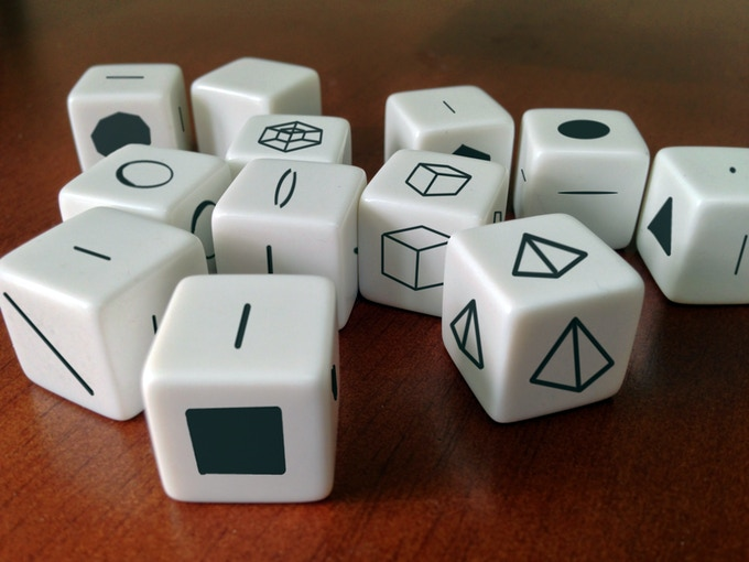 Twelve custom pieces are included in each set (prototype shown)