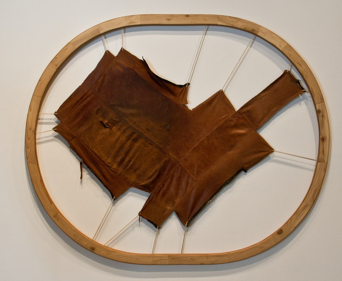 "Pelt 1, (in collaboration with Kevin Reiswig), skinned ottoman, alley-harvested leather, 40"" x 60"", 2011"