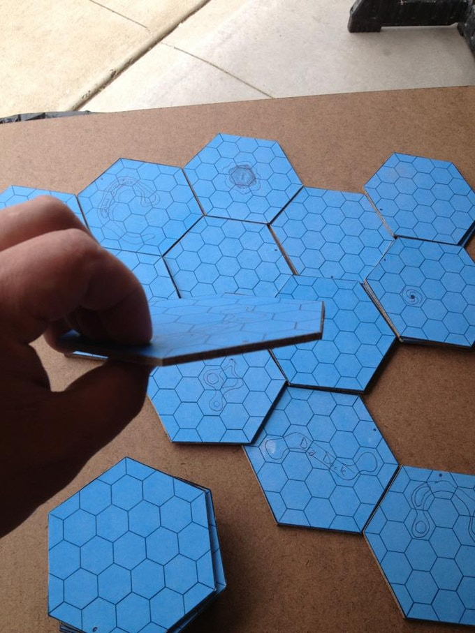 Then we glued our paper proto-art onto hardboard and hand cut all our tiles....