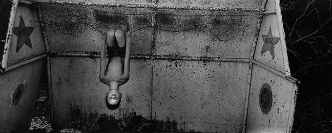 Isla Limited Edition three: Boy hanging upside down, Trinidad, 2005