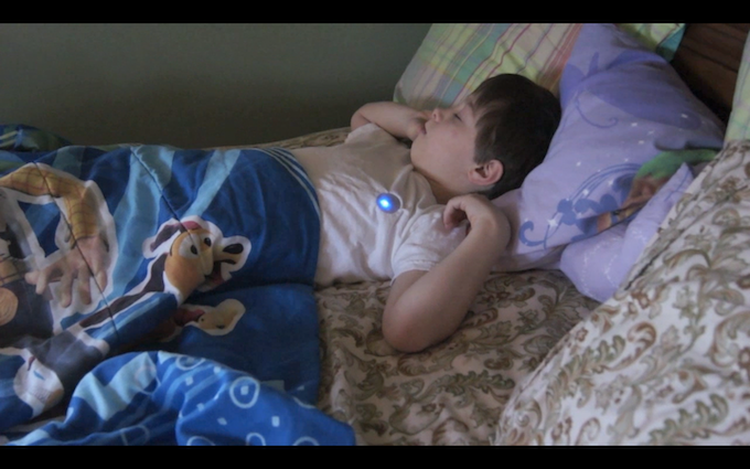 A kid sleeping with Monbaby