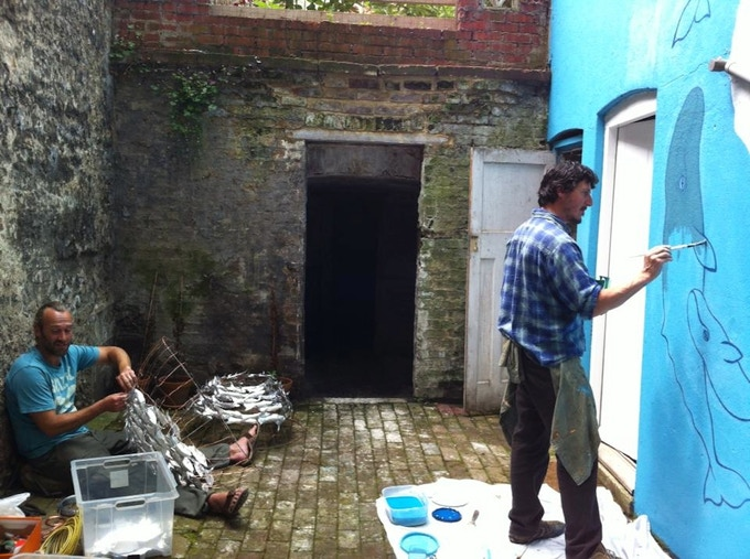 Artists John Ives and James Eddy making work in the ONCA courtyard