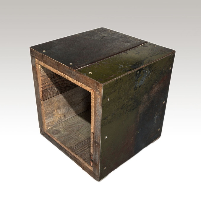 hollow cube made of metal industrial shelving and weathered cedar fencing