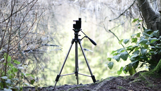 The MicrobeScope mounts on a tripod for hands free sample collection.