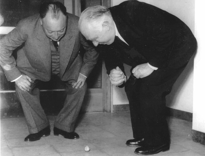 Nobel laureates in physics, Wolfgang Pauli (left) and Niels Bohr, observing the Tippe Top (photo courtesy of the Niels Bohr Archive)