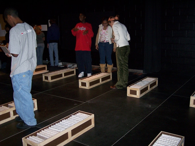 Salem High school students viewing the crates of books they made.