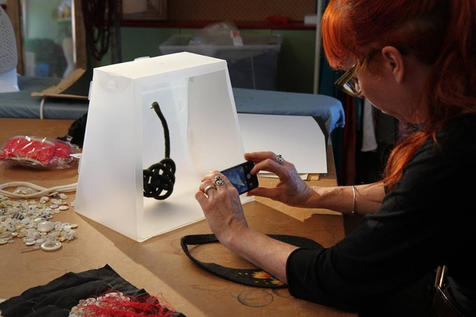 Lucy Armstrong using the Lightcase to photograph her textile work