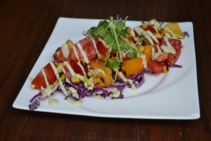 Or a lack of seasonally inspired, locally sourced dishes like this Roasted Corn & Tomato Salad with Roasted Jalapeno Aioli