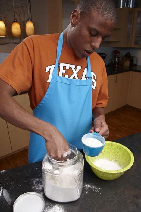 Lucas measuring flour