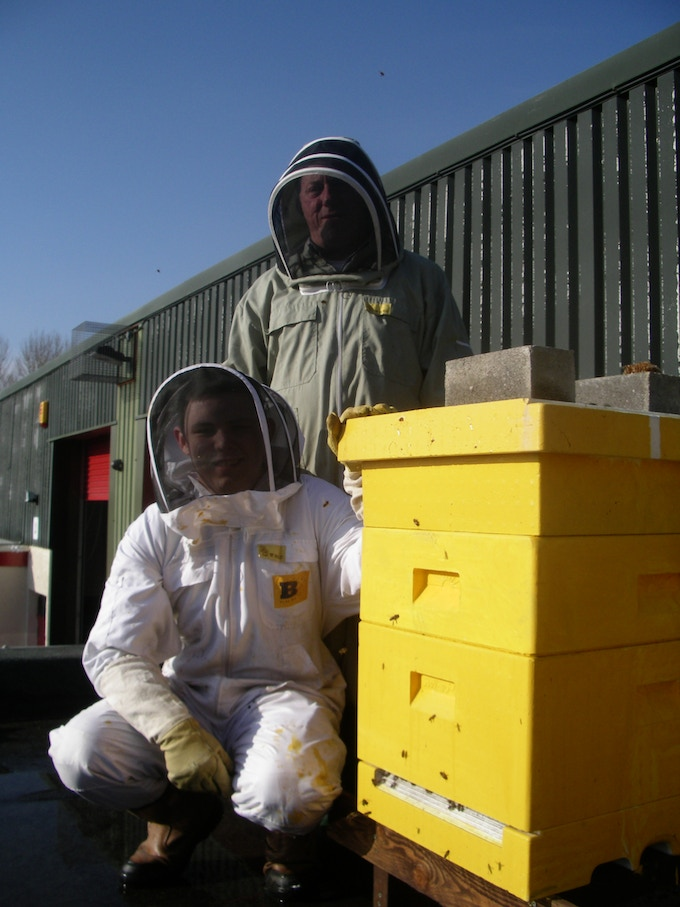 Warren & Liam tending to one of our beehives at the office