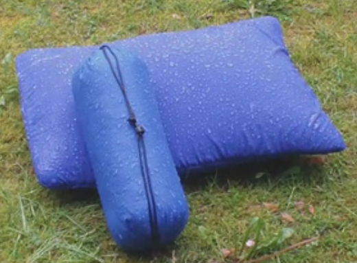 This pillow exterior is a very soft, breathable Supplex nylon that feels and breathes like cotton, but resists water. The carrying case is made of a tough water proof rip-stop nylon